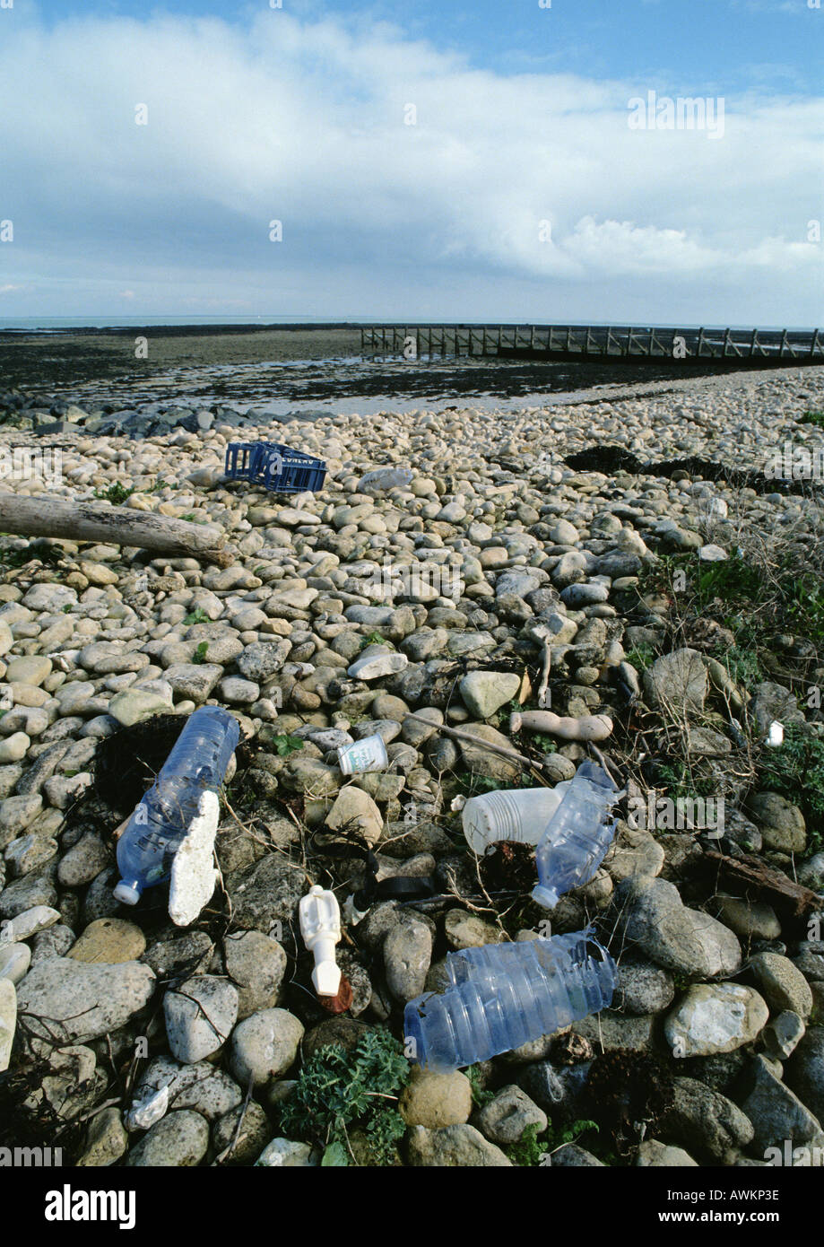 Trash scattered on rocky beach Stock Photo