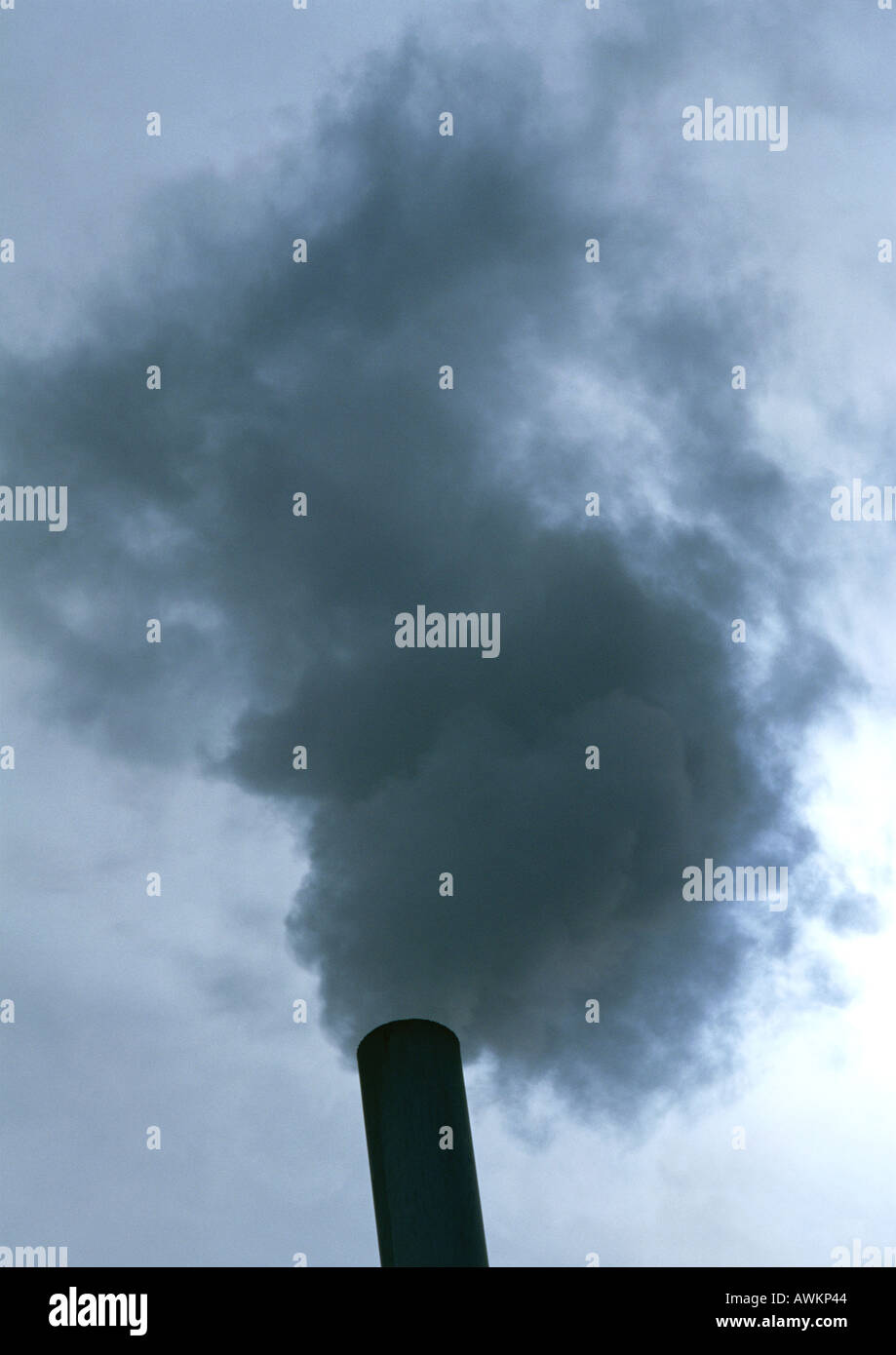 Smoke from a smoke stack, low angle view - Stock Image