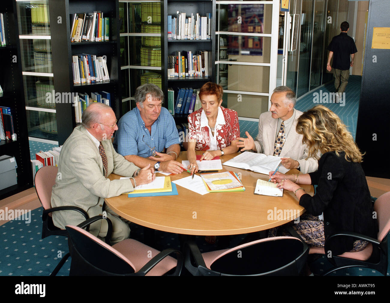 Five people sitting in conference room, high angle view - Stock Image