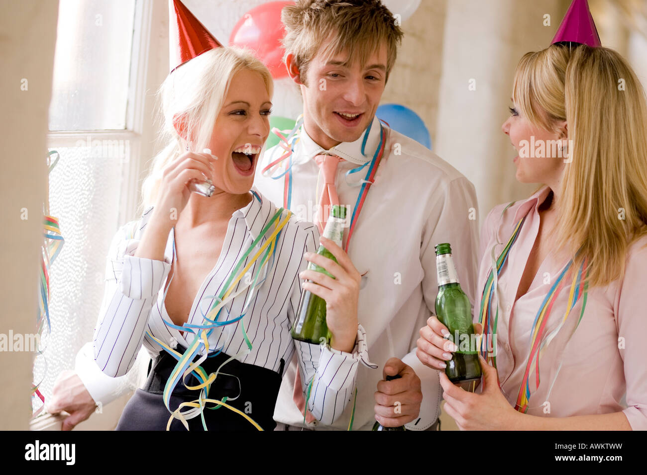 group of people drinking at an office party - Stock Image