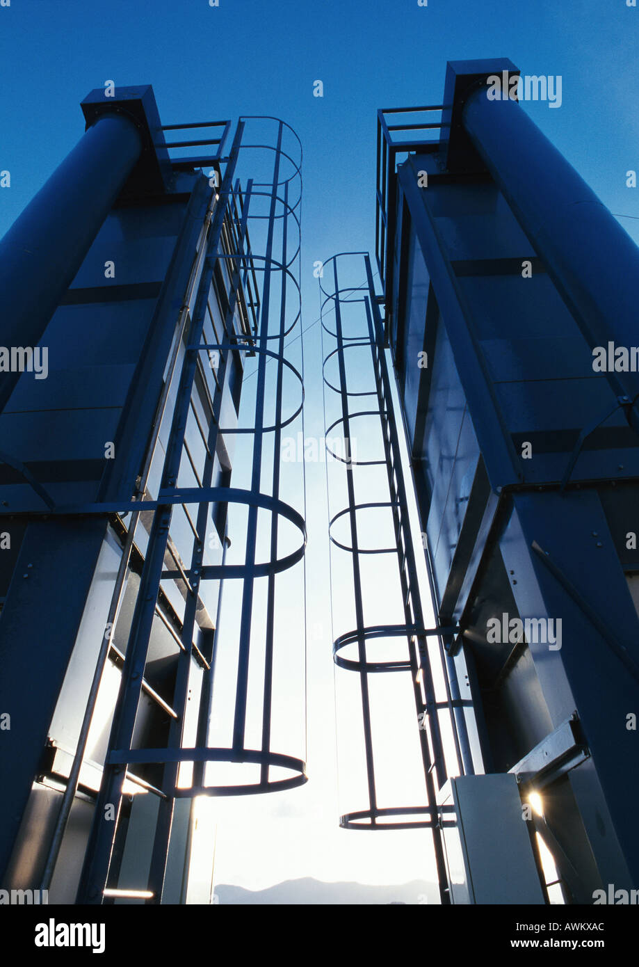 Two ladders in thermal power plant, low angle view - Stock Image