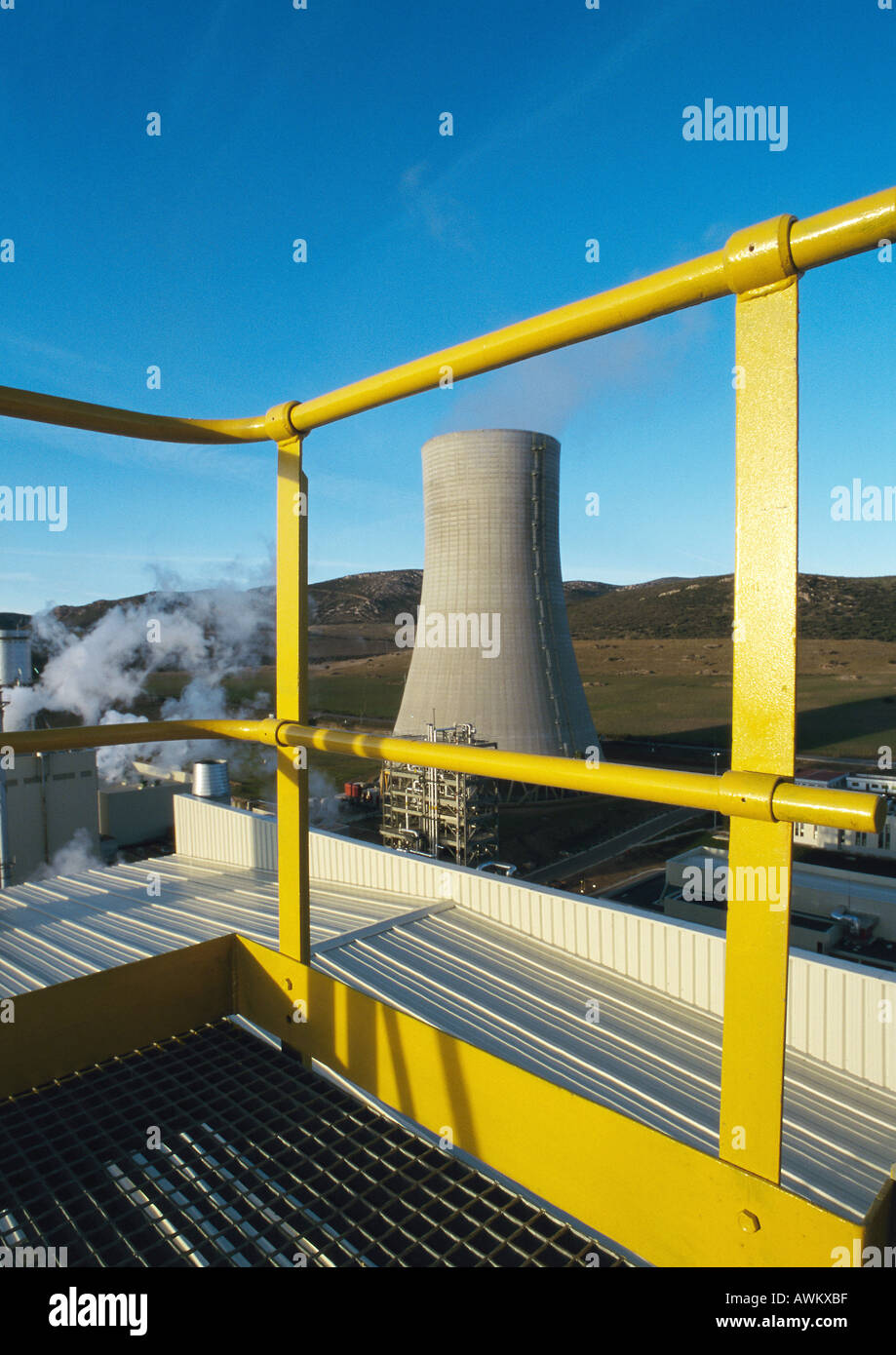 Guard rail, thermal power plant in background - Stock Image