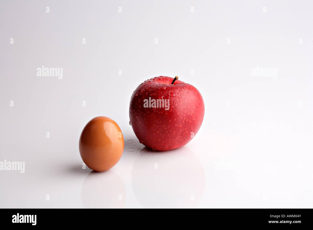 Boskoop apple beside a brown egg Stock Photo