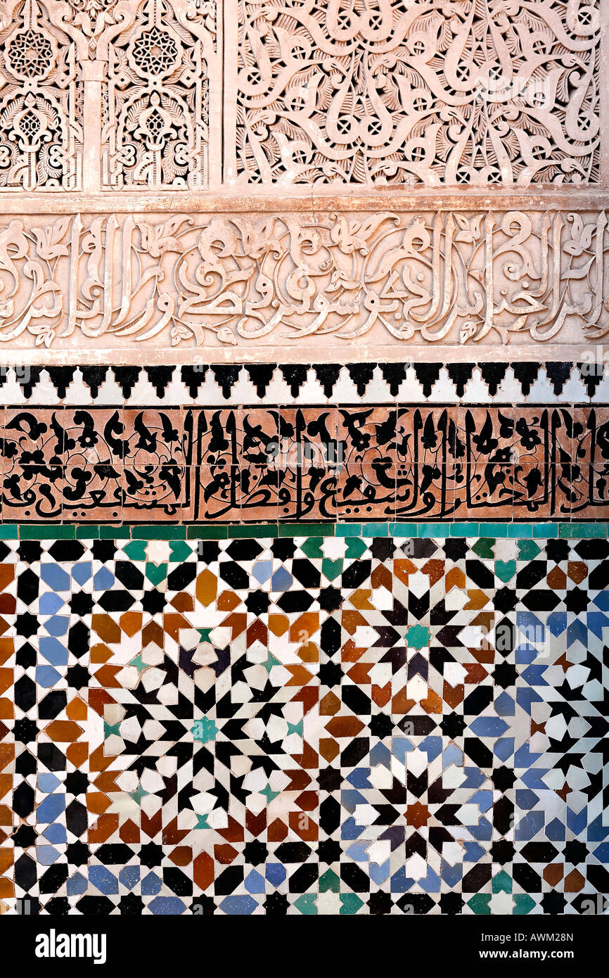 Tile wall decorated with ornate arabesque designs, Ali-Ben-Youssef madrasah, historic theological academy in the - Stock Image