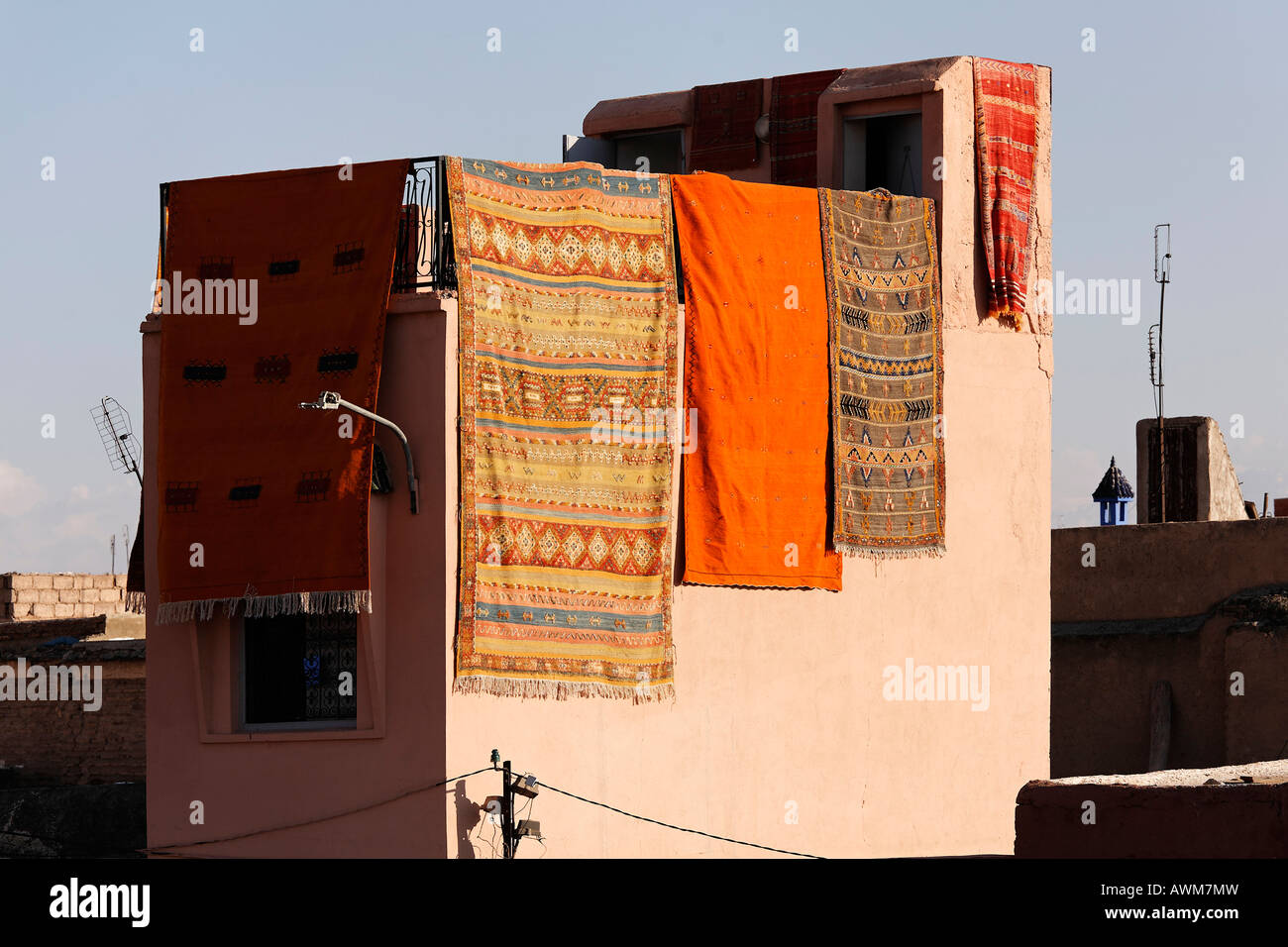 Souk house draped with colourful Berber carpets, Marrakech, Morocco, Africa - Stock Image