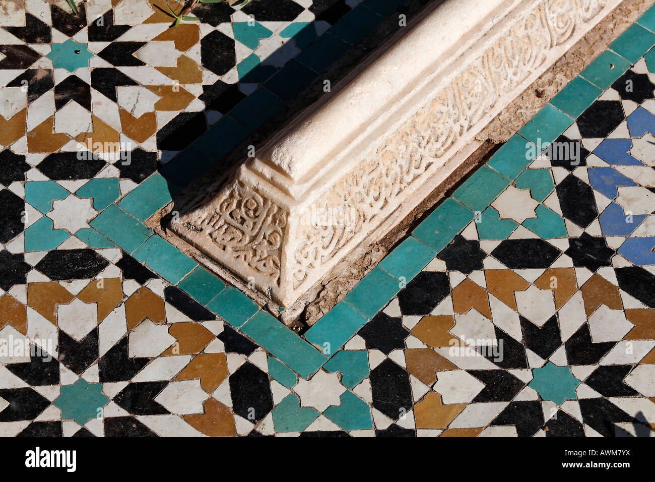 Arabic gravestone with arabesque inscription surrounded by coloured tiles, Saadien Tombs, Medina, Morocco, Africa - Stock Image