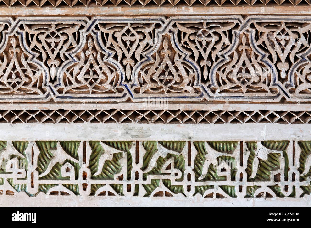 Artistic arabesque stucco work, Palais de la Bahia, Medina, Marrakech, Morocco, Africa - Stock Image