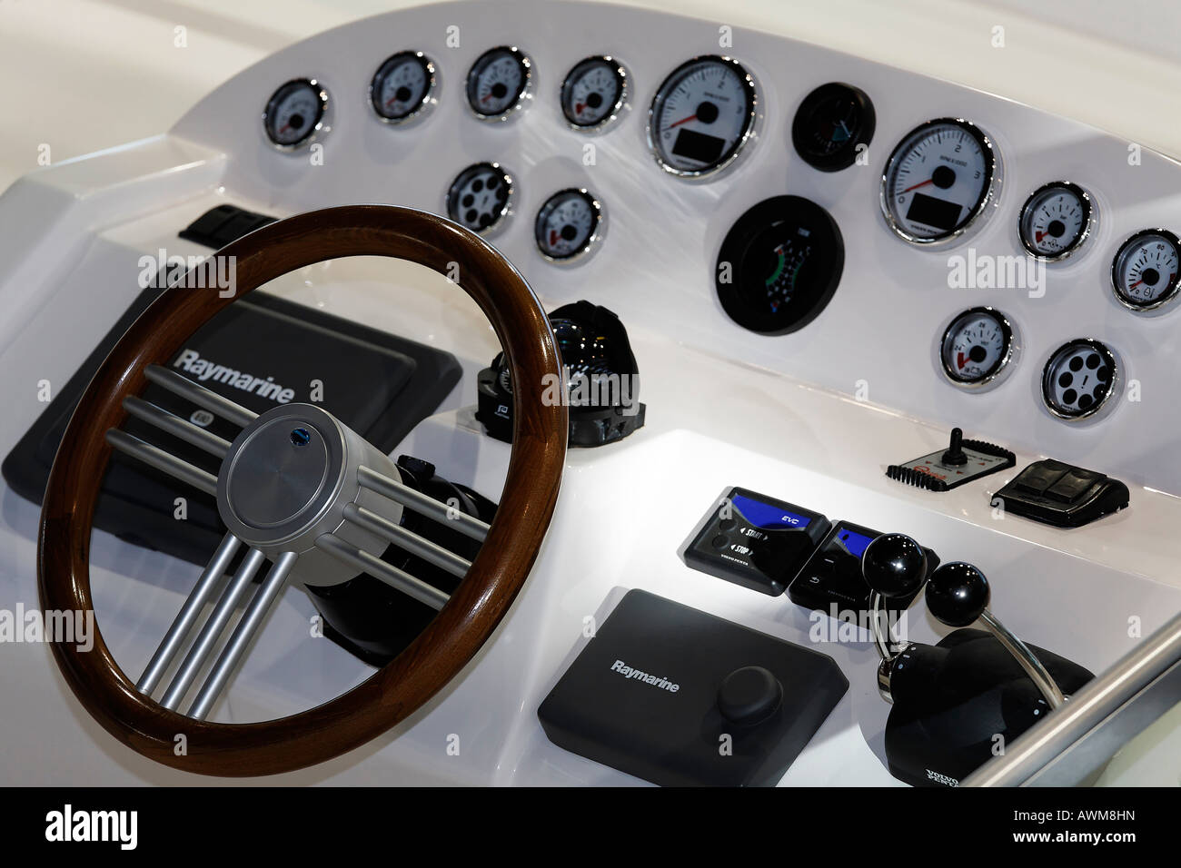 Wooden wheel and instruments of a luxury yacht, world's biggest showcase for yachting and water sports, Duesseldorf, - Stock Image