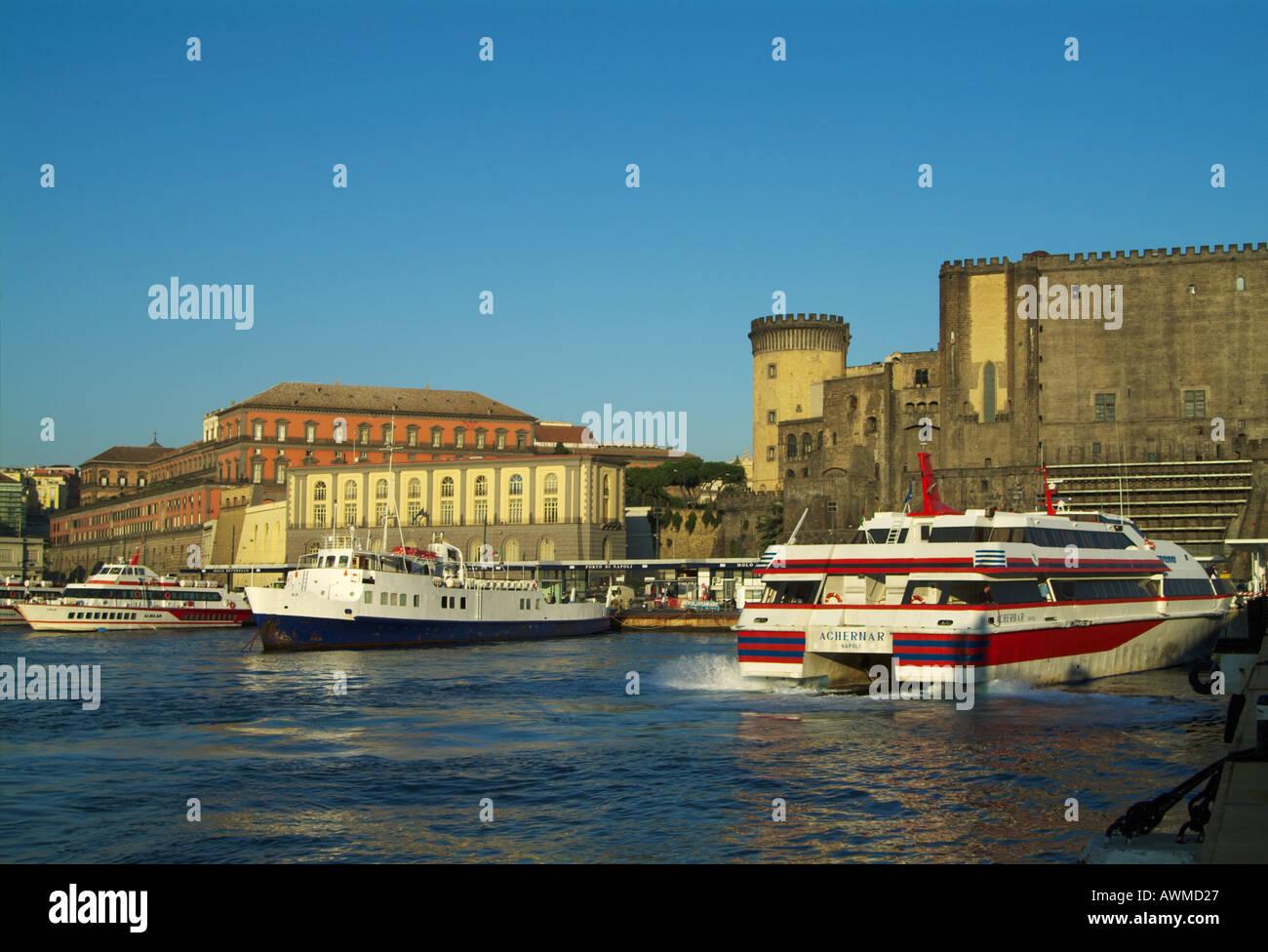 Ferryboats at harbor, Castel Nuovo, Campania, Naples, Italy - Stock Image