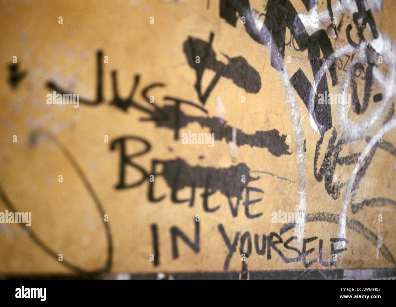 Just believe in yourself written text and graffiti on wall, close-up ...