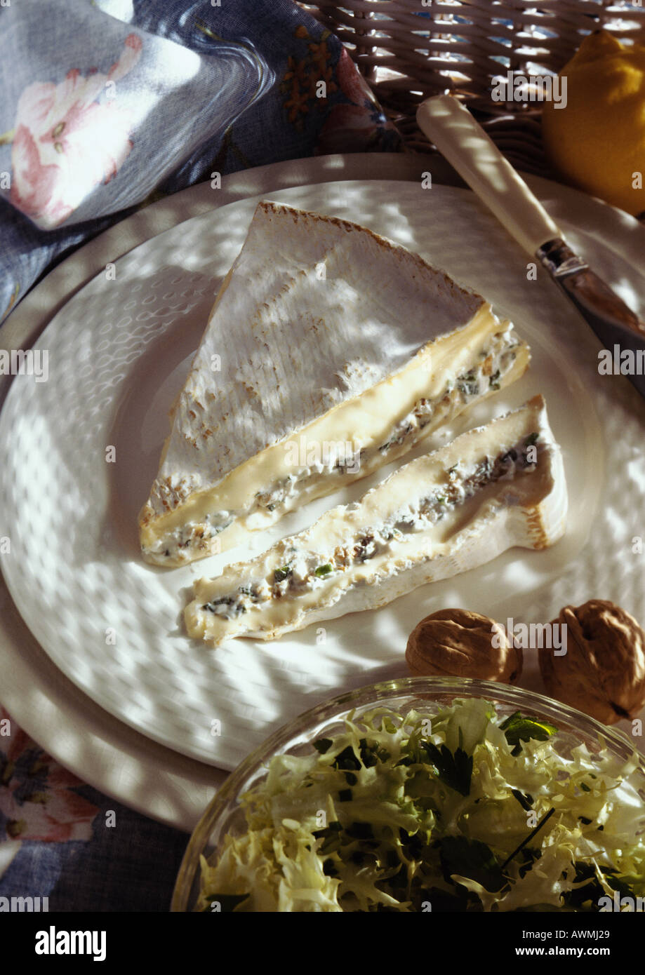 Stuffed brie on plate, high angle view - Stock Image