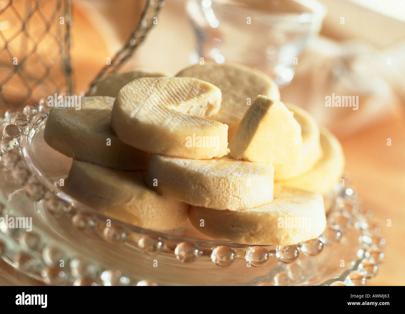 Stack of goat cheese on plate, close-up - Stock Image