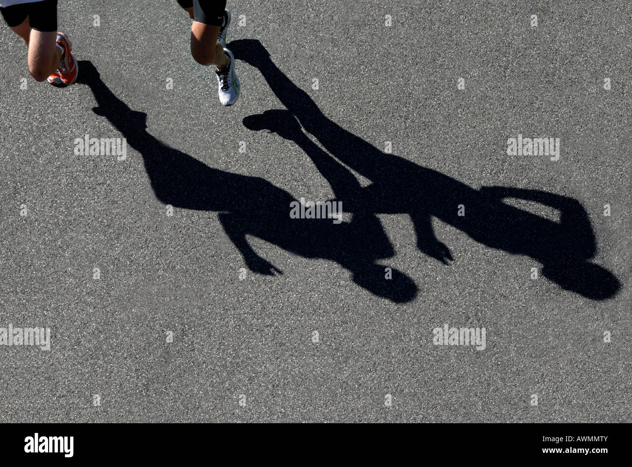 Shadows of two marathon runners from bird´s eye view - Stock Image