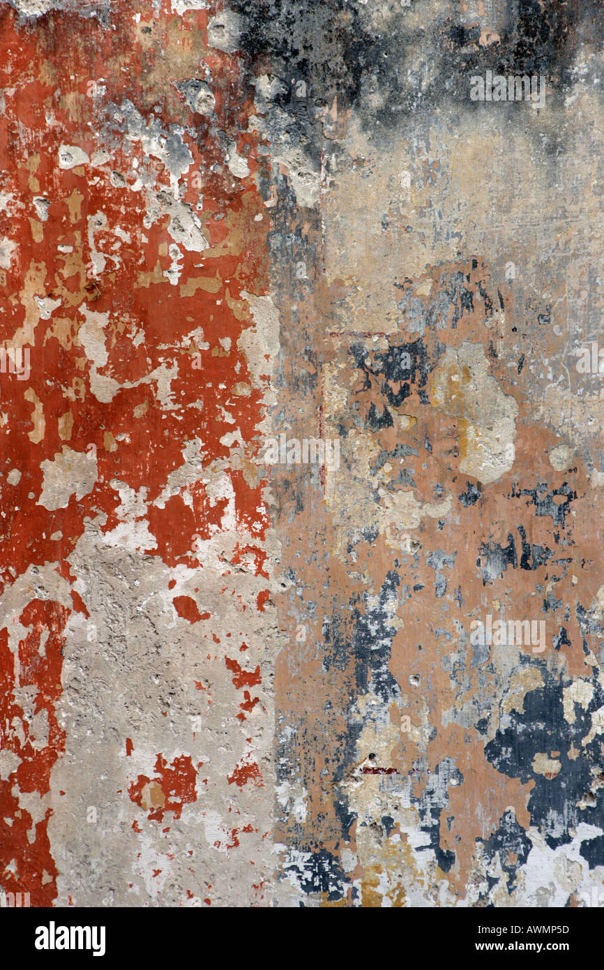 Peeling paint on a cement wall makes for an abstract background. - Stock Image