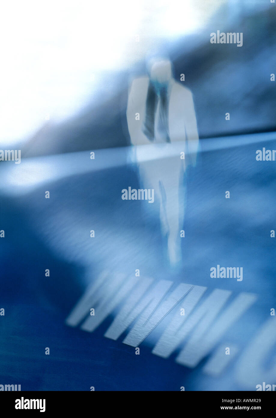 WWW symbol and male figure, composite, close-up - Stock Image