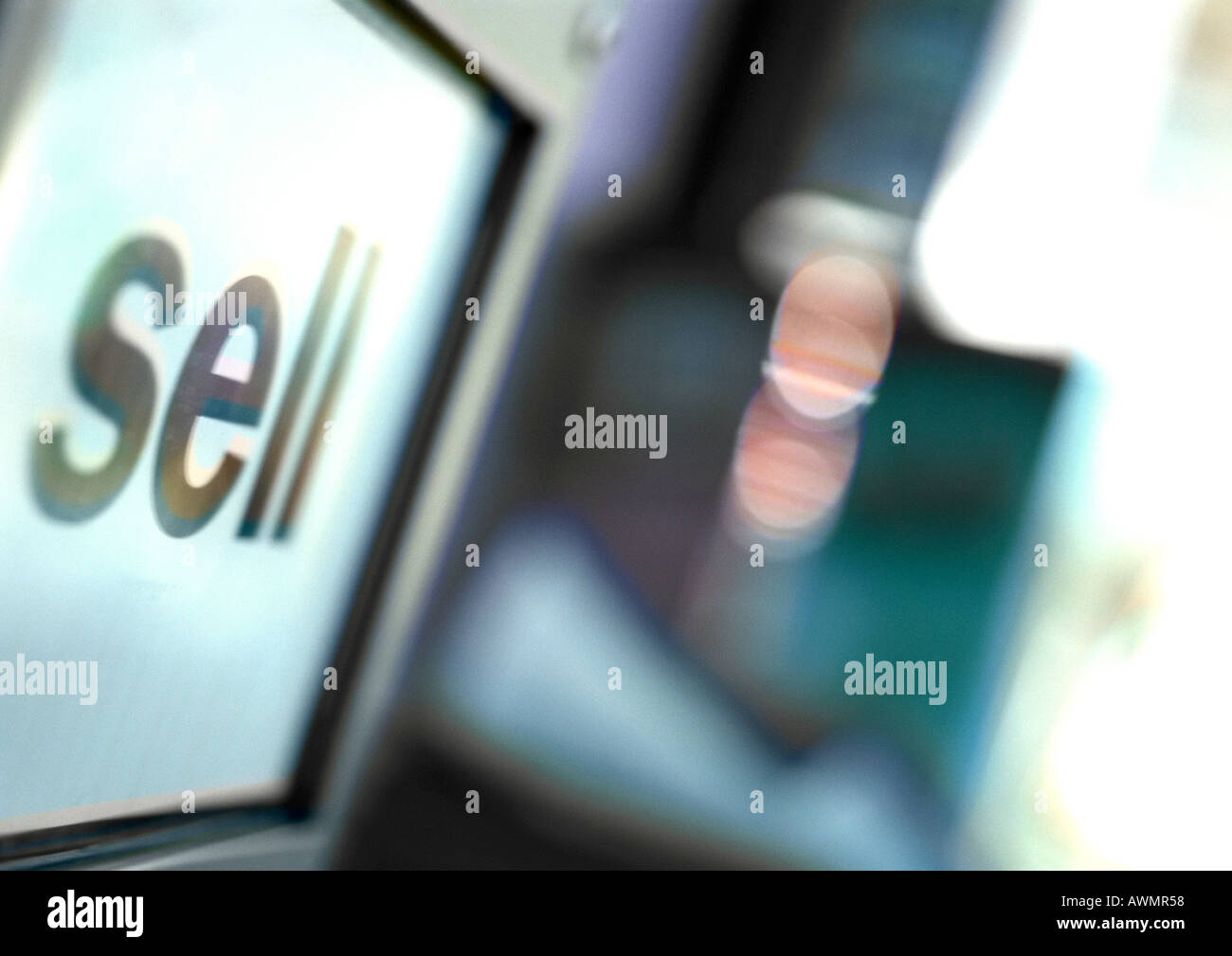 Sell text on screen, close-up - Stock Image