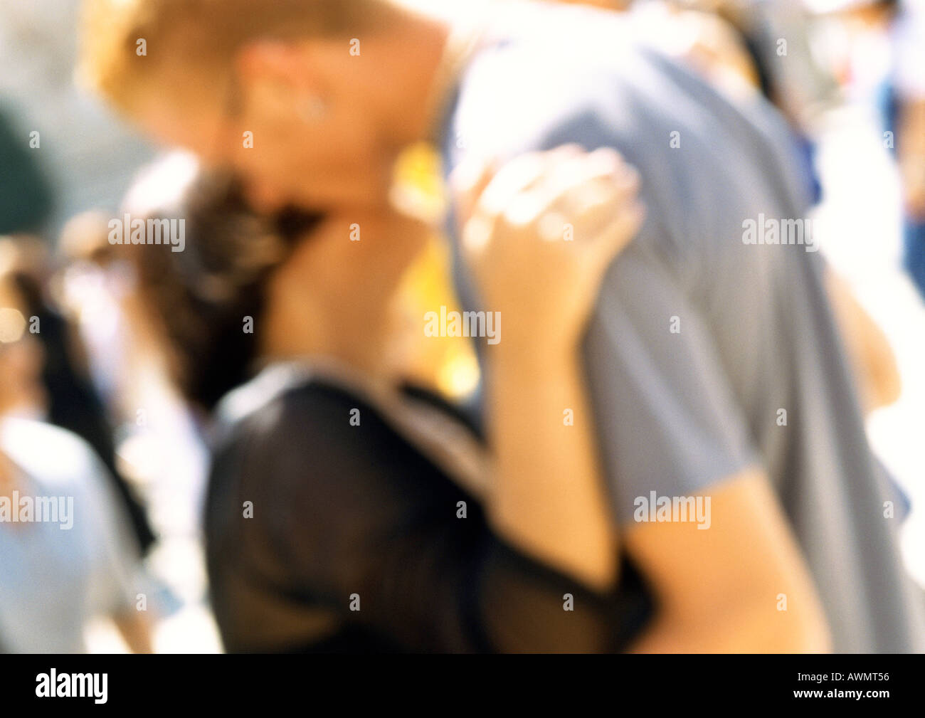 Man and woman hugging, close up, blurred - Stock Image