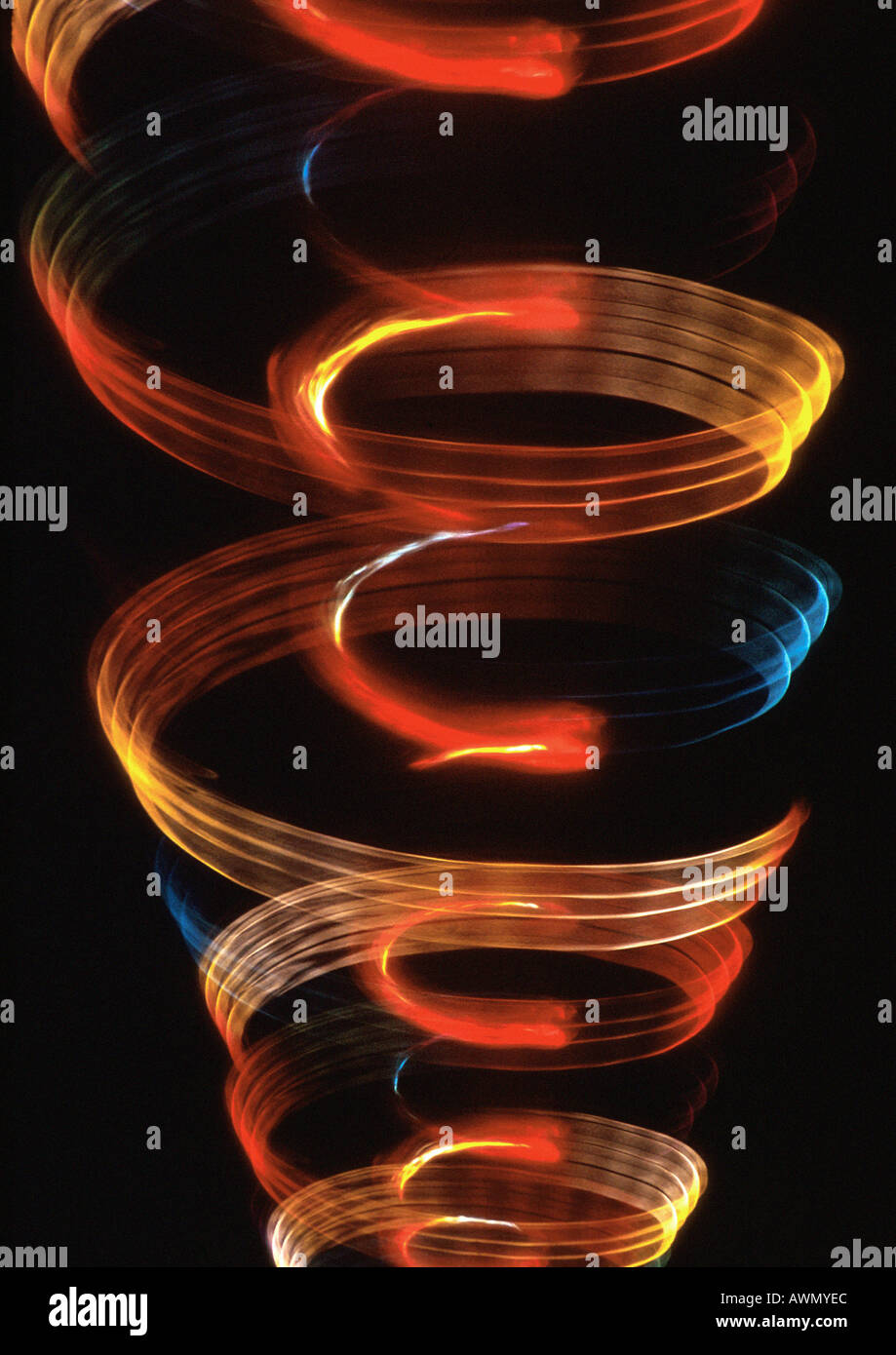 Spiraling light effect, one within the other, oranges, reds and blues. - Stock Image