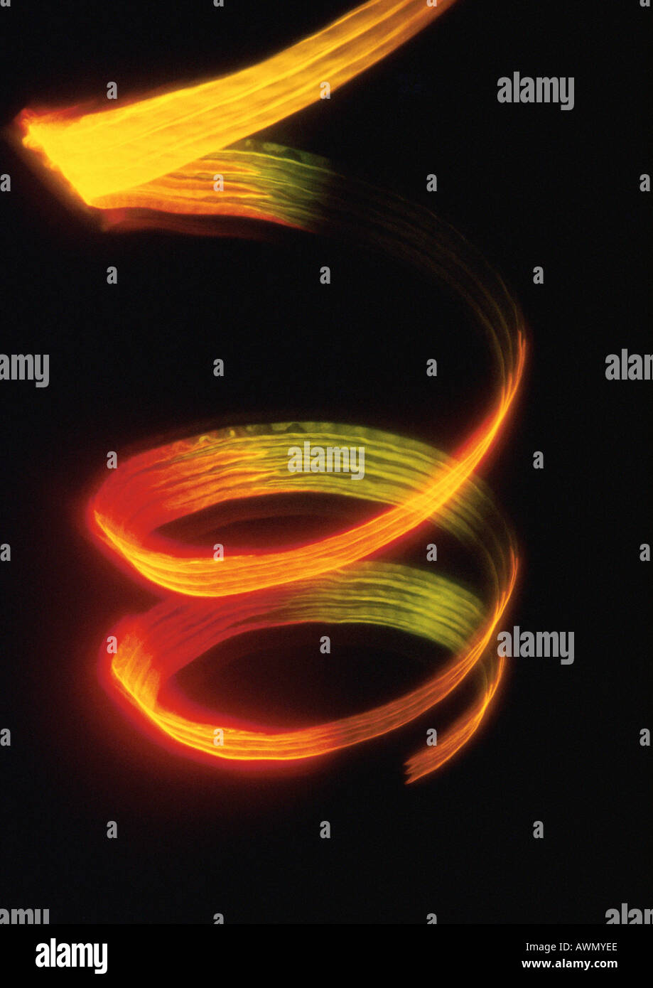 Spiraling light effect, reds and yellows. - Stock Image