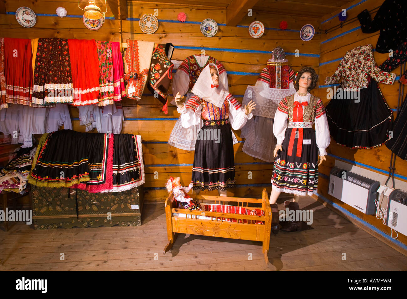 Traditional, handcrafted womens' clothes, on the left a married woman's dress and on the right a virgin's - Stock Image