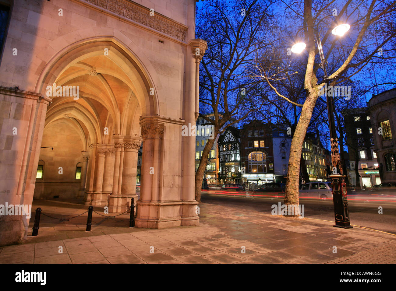 Arcades of the Royal Courts of Justice and Tudor houses on Strand, City of Westminster, London, UK - Stock Image