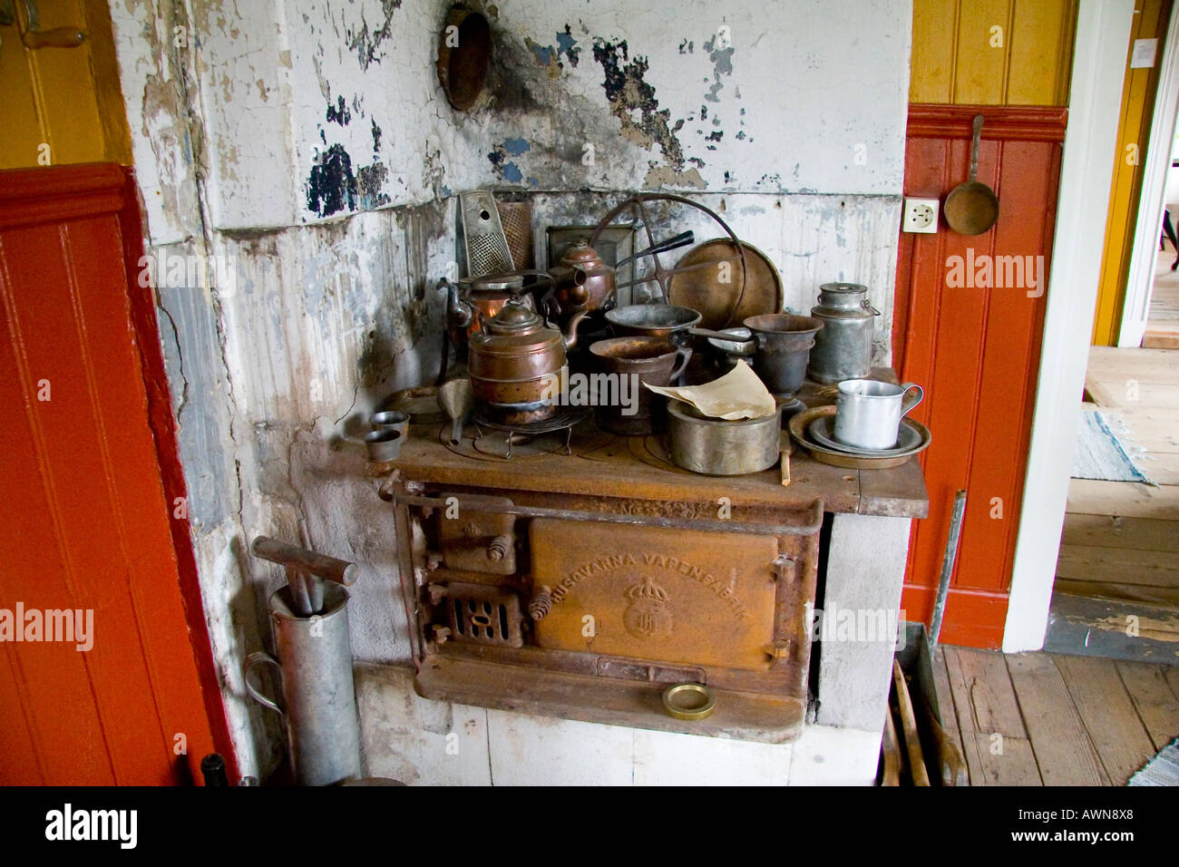 Old swedish stove with households - Stock Image