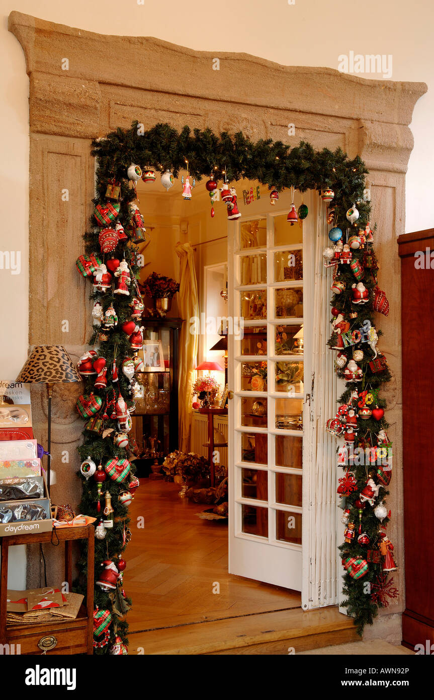 Living Room Doorway Decorated With Christmas Garland Stock