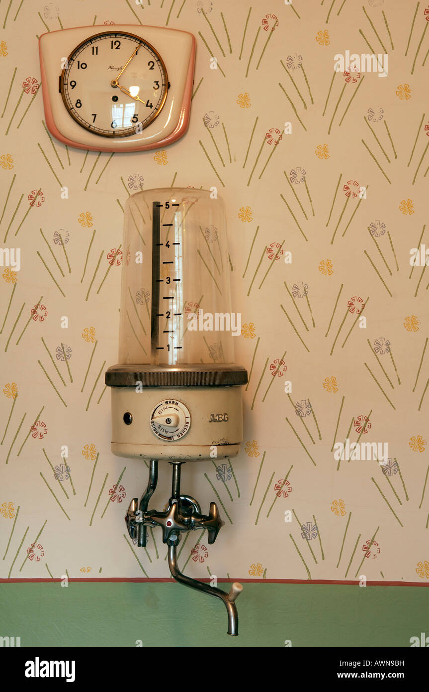 1950s kitchen clock and water boiler mounted on wall, Lauf an der Pegnitz, Middle Franconia, Bavaria, Germany, Europe Stock Photo