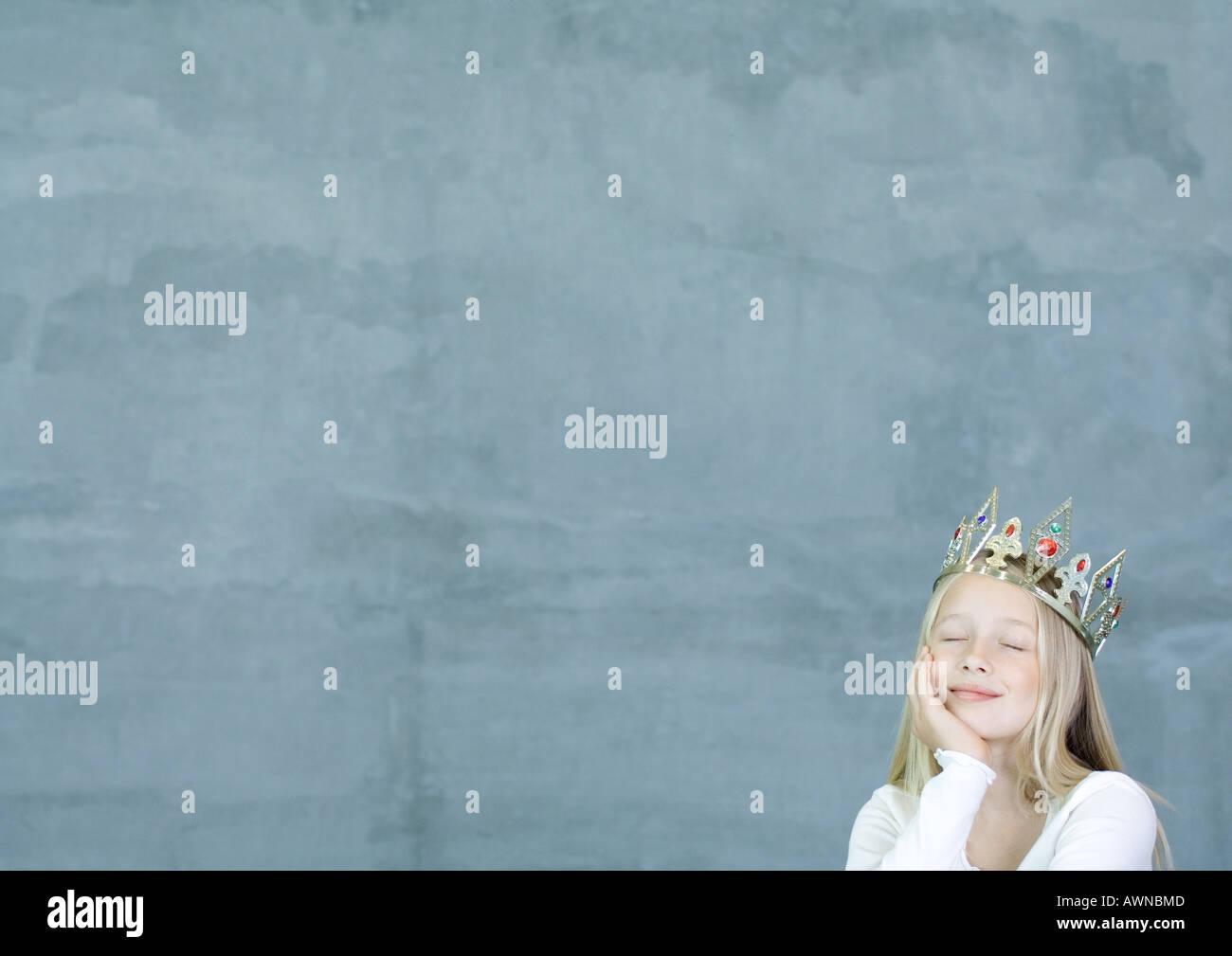 Girl wearing crown - Stock Image