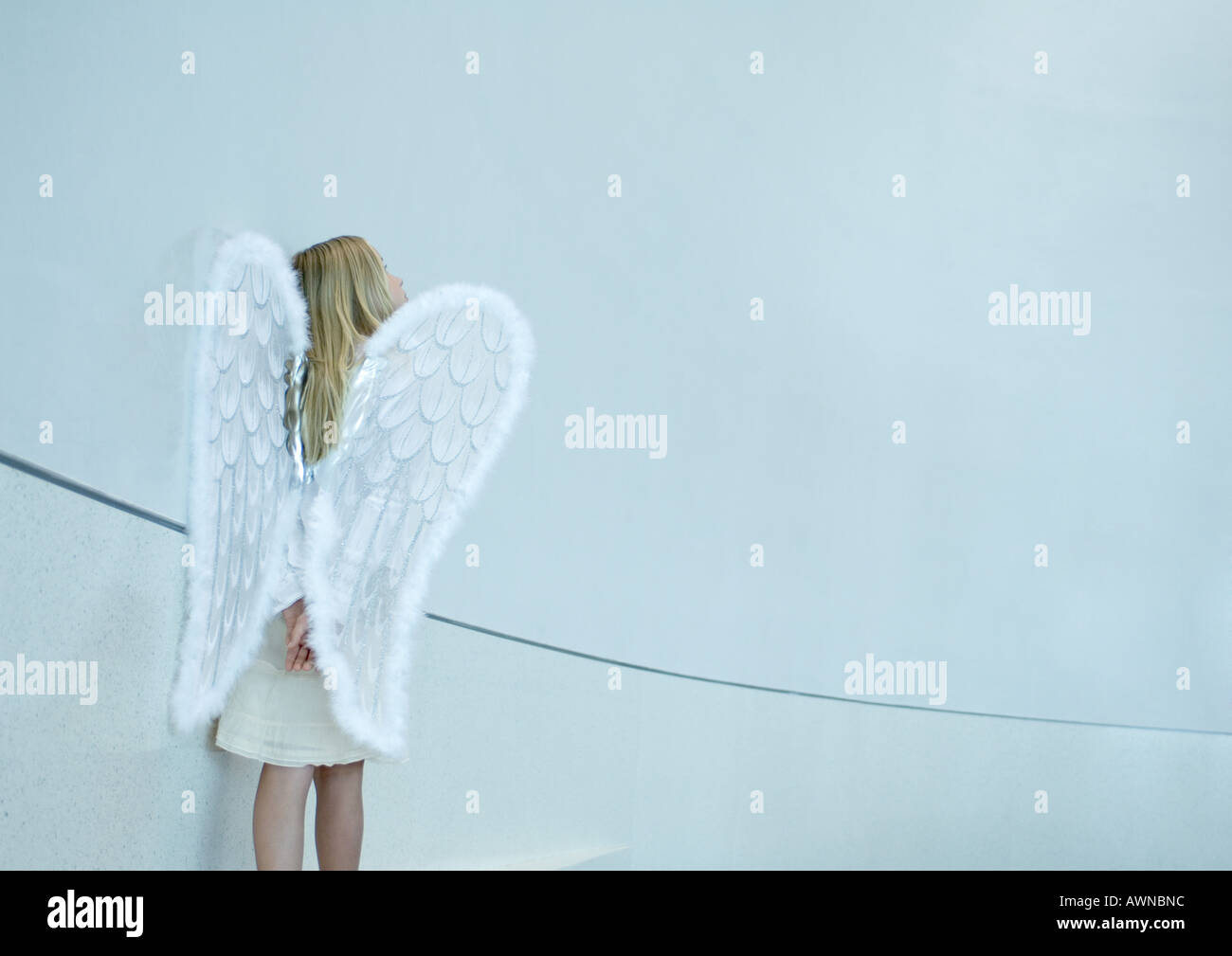Girl wearing angel wings Stock Photo
