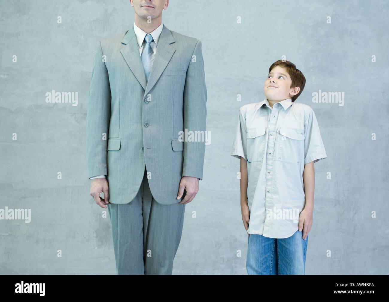 Boy imitating businessman - Stock Image