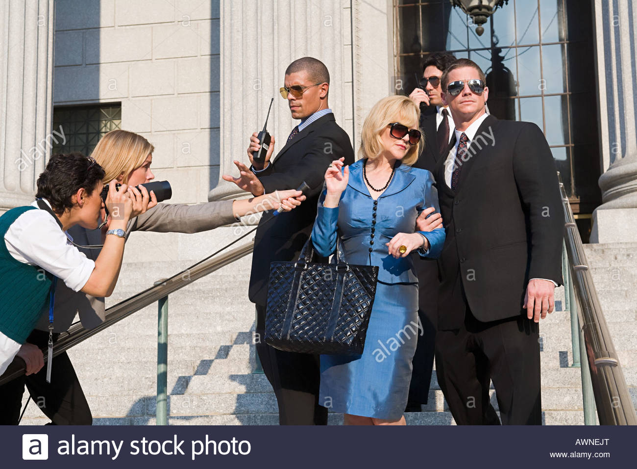 Body guards protecting a woman - Stock Image