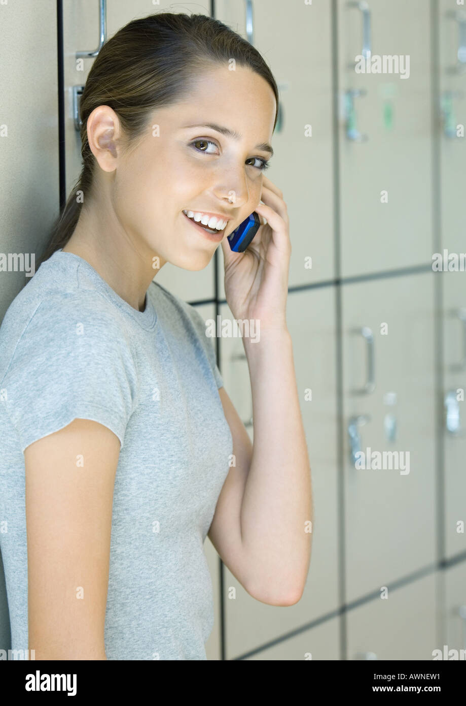 Preteen girl using phone - Stock Image