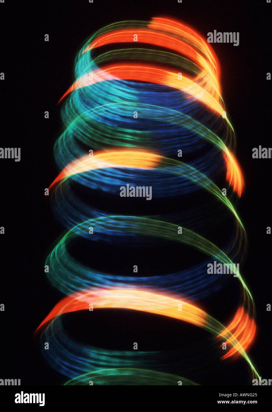 Spiraling light effect, reds, blues and yellows. - Stock Image