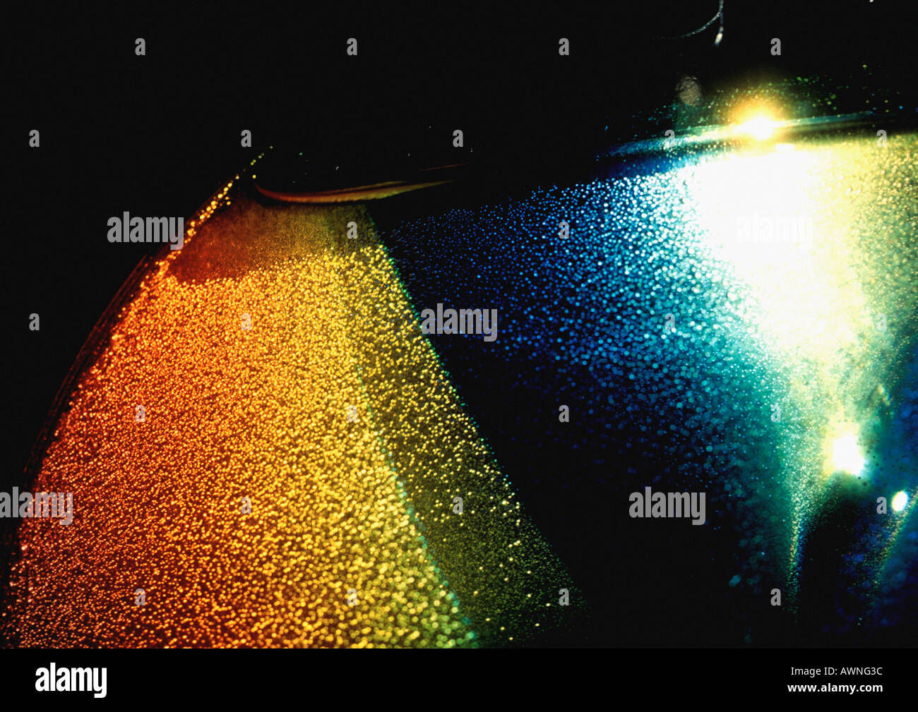 Textured light effect, yellows, blues and reds. - Stock Image