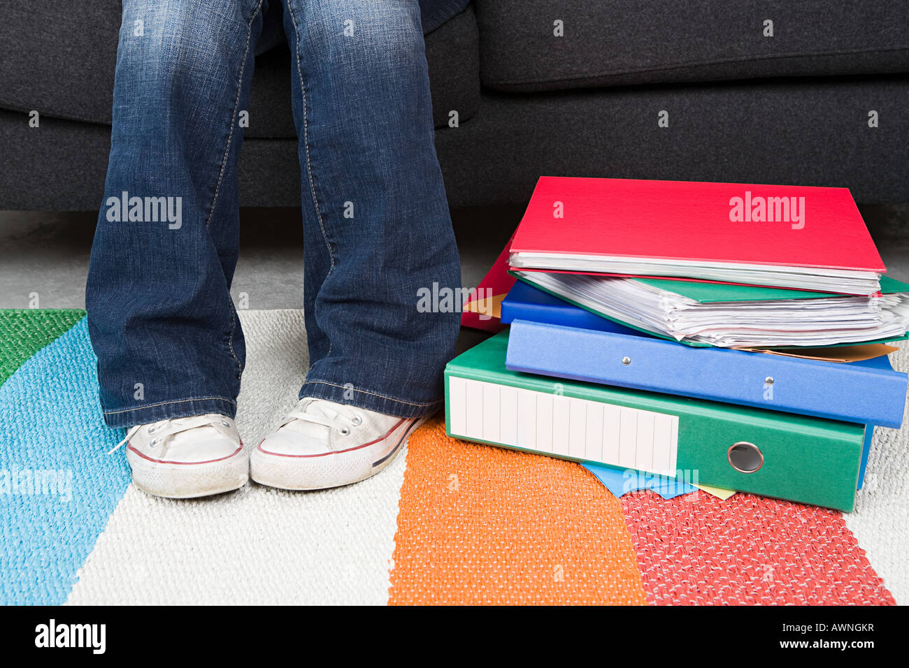 Human legs and ring binders - Stock Image