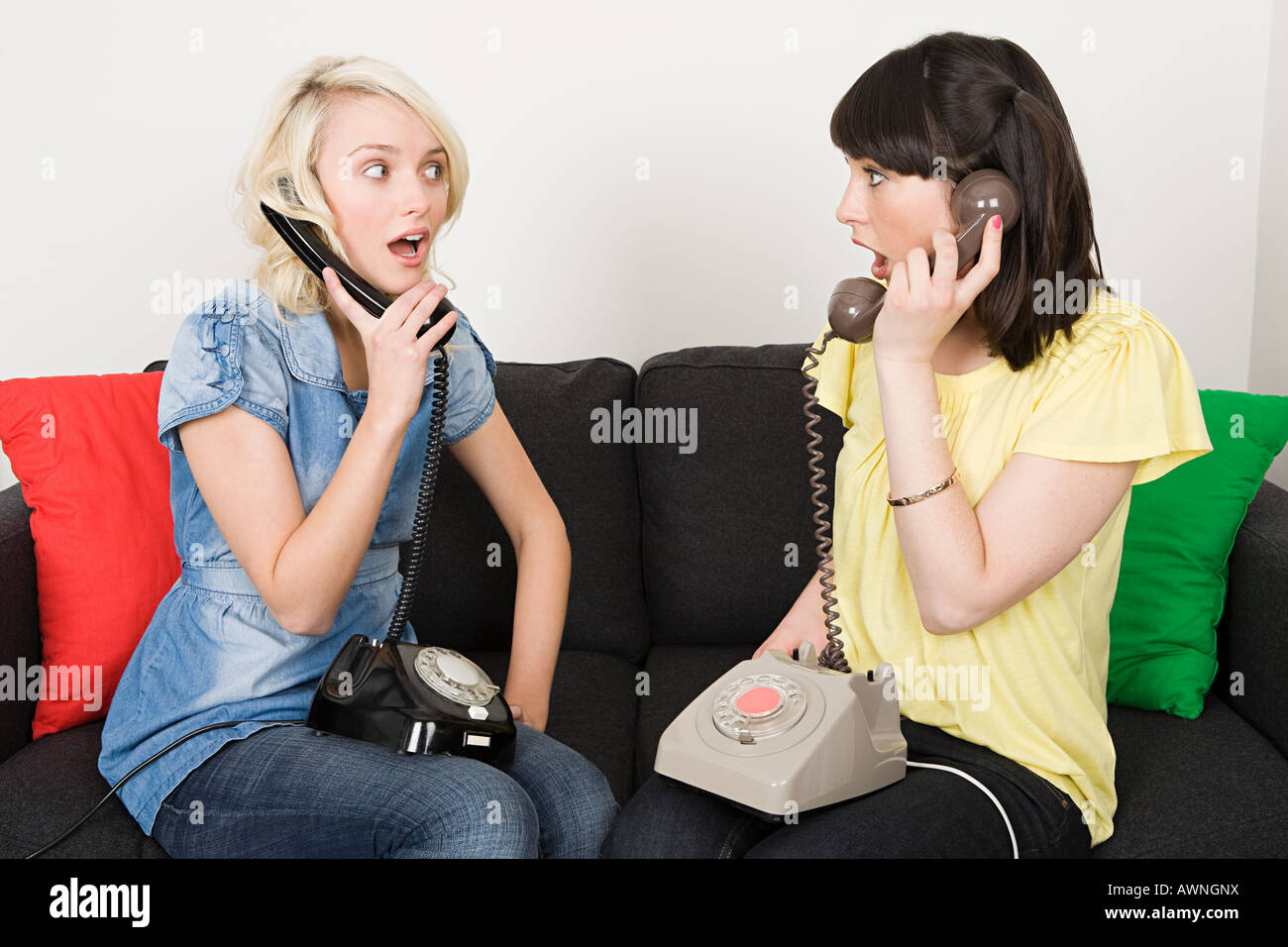 Two women having telephone conversations - Stock Image
