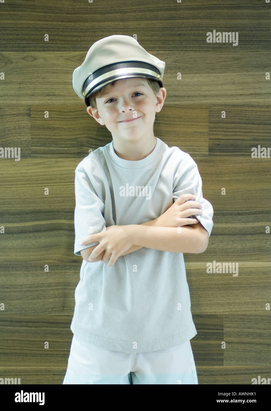 Boy wearing captain's hat - Stock Image
