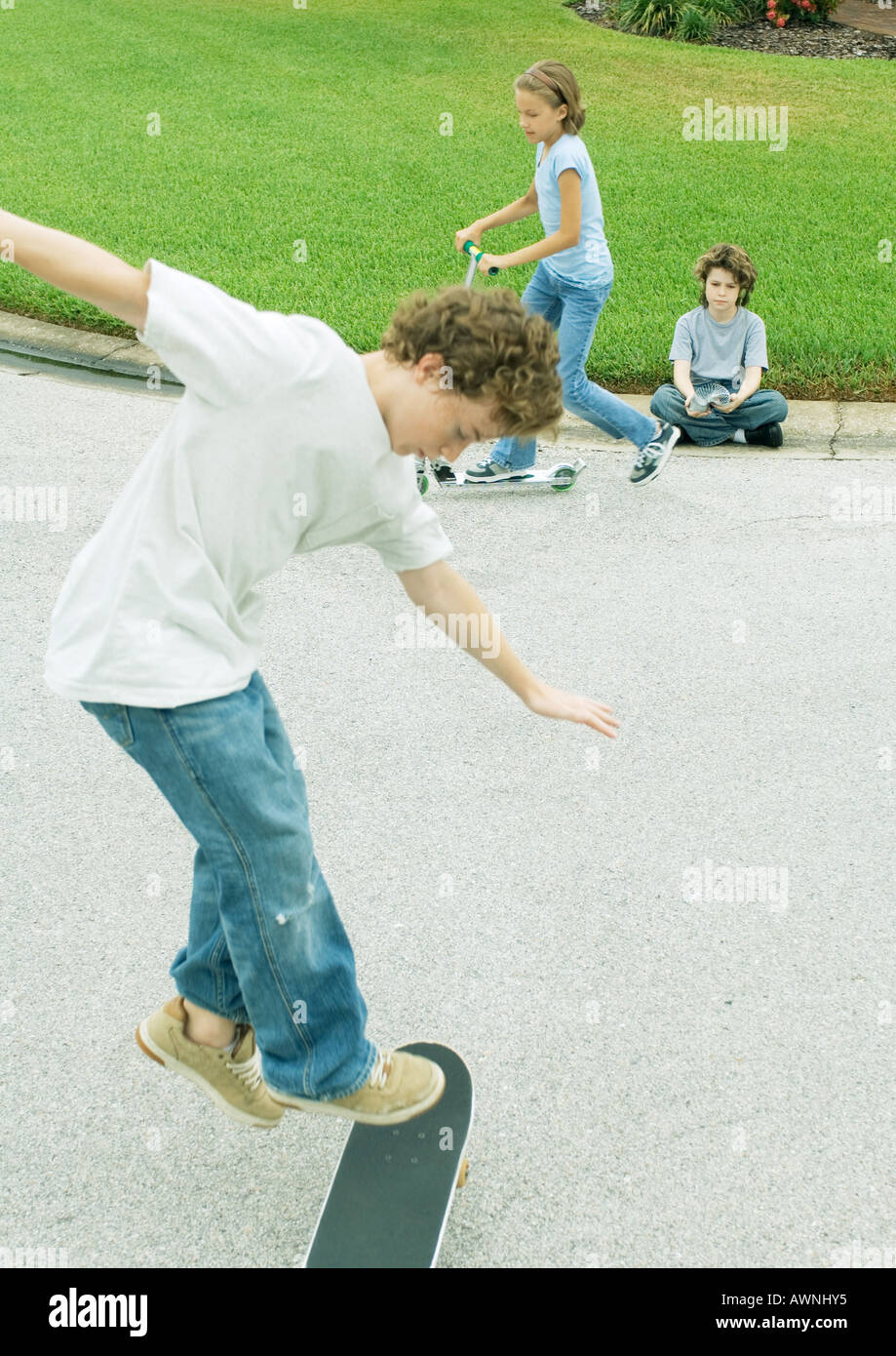 Suburban children playing in street - Stock Image