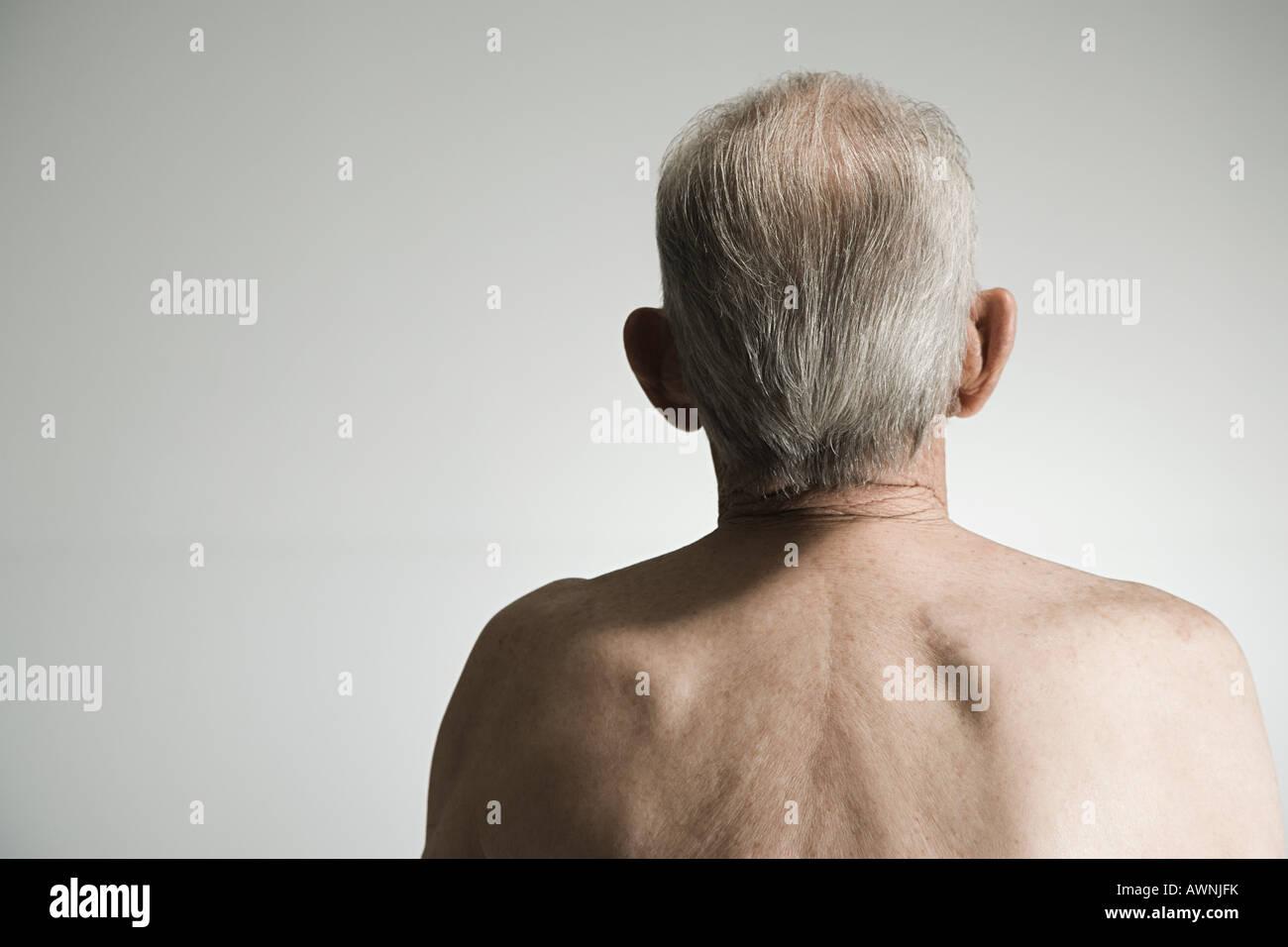 Rear view of a senior man - Stock Image