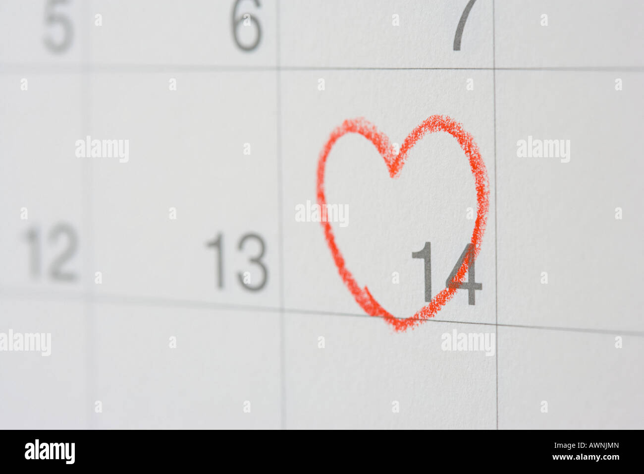 Number fourteen with a heart round it - Stock Image
