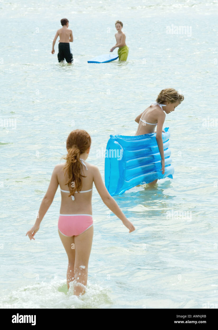 Children playing in water at the beach Stock Photo