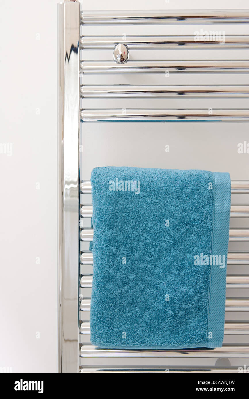 Towels drying on a radiator - Stock Image