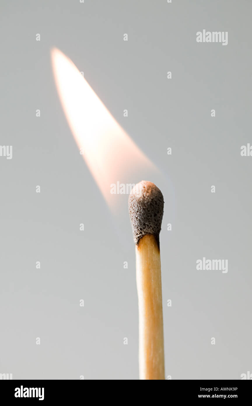 A burning match Stock Photo