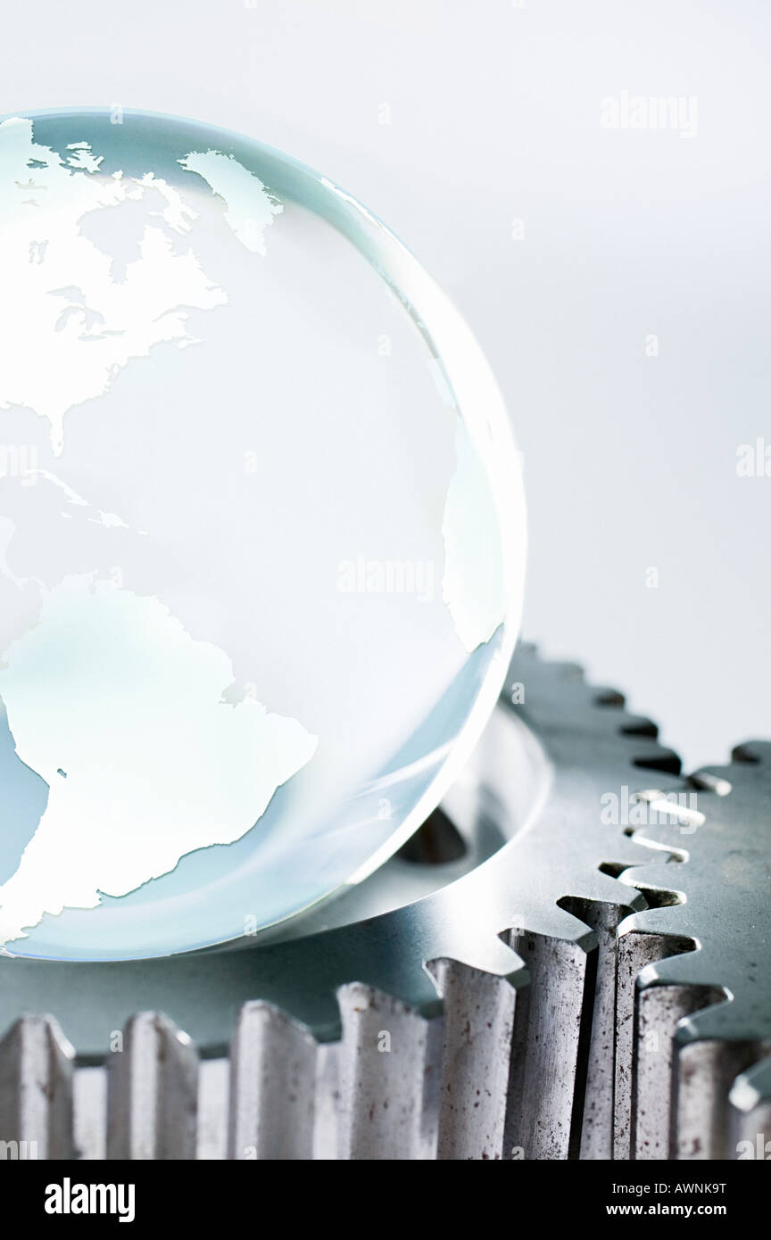 Planet earth and machine cogs Stock Photo