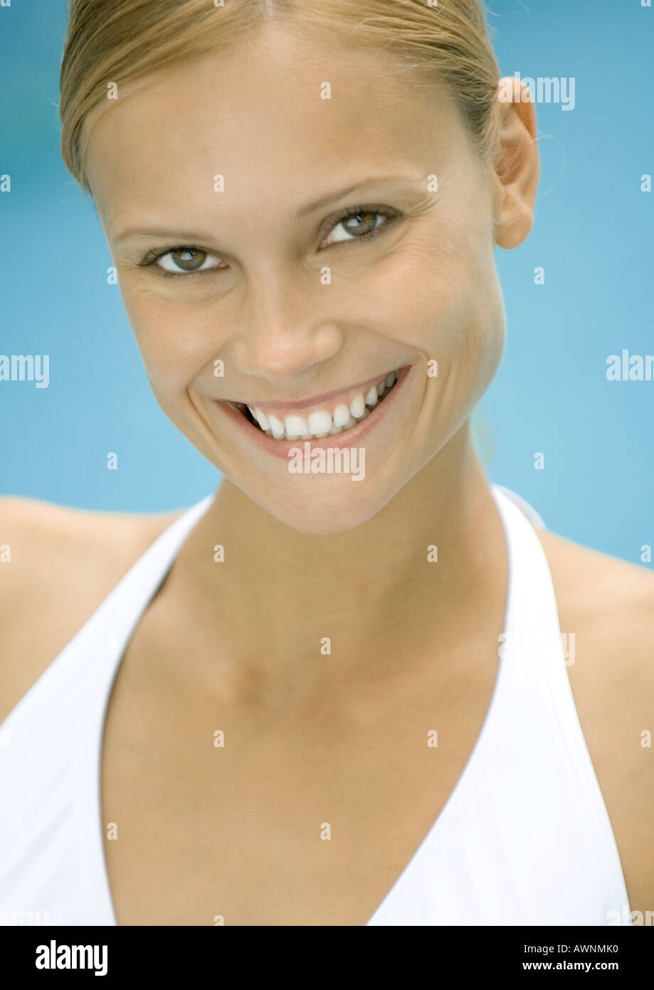 Woman in bathing suit smiling, potrait - Stock Image