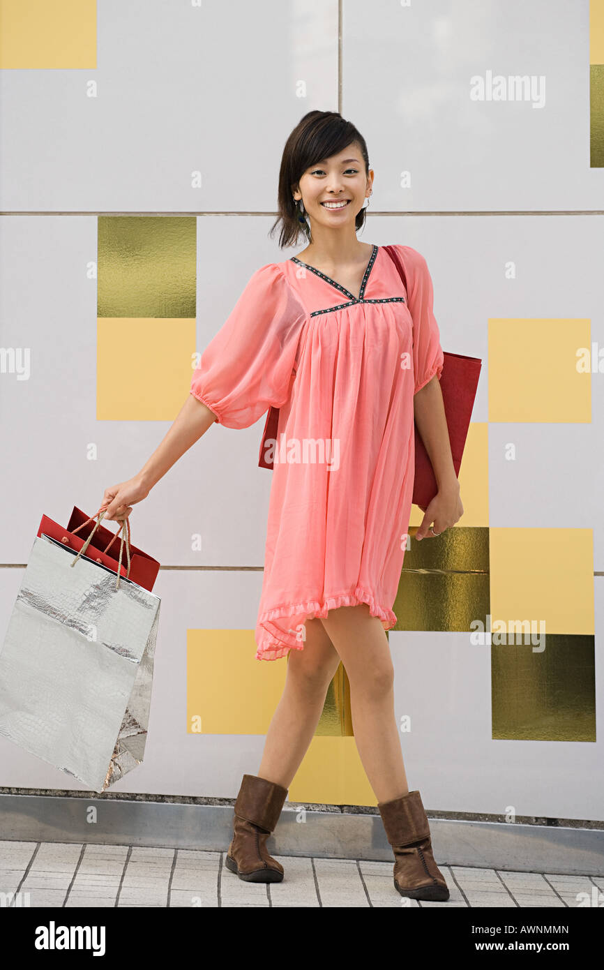 A woman holding shopping bags - Stock Image