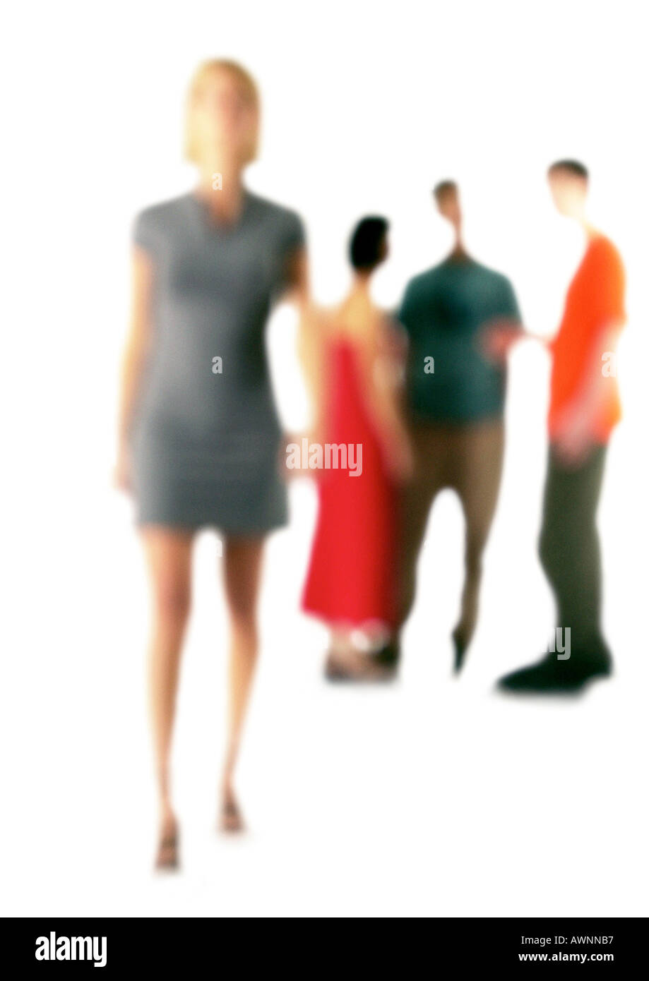 Silhouette of woman standing apart from group of people, on white background, defocused - Stock Image
