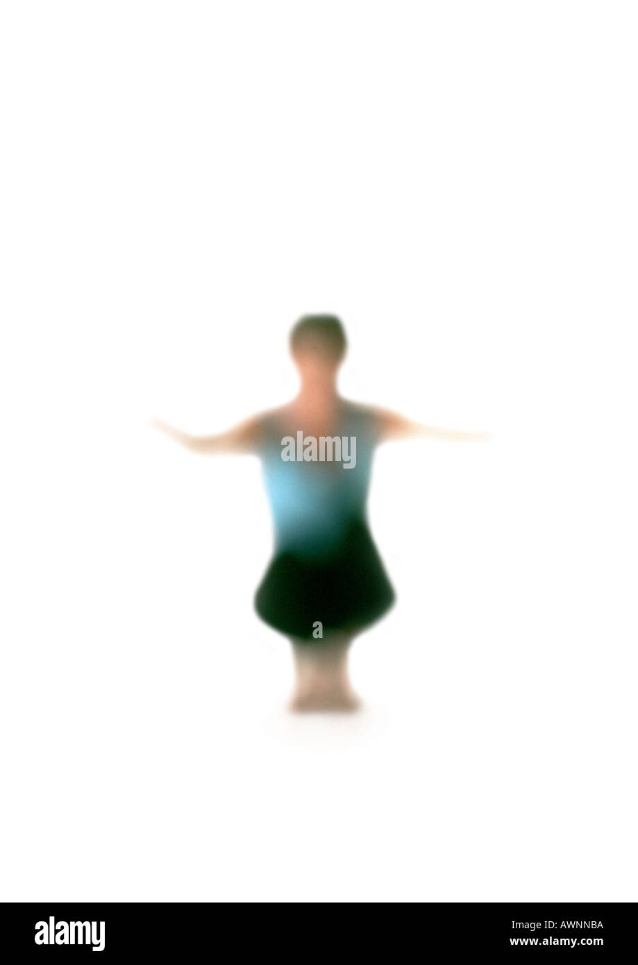 Silhouette of woman squatting down with arms out, on white background, defocused - Stock Image