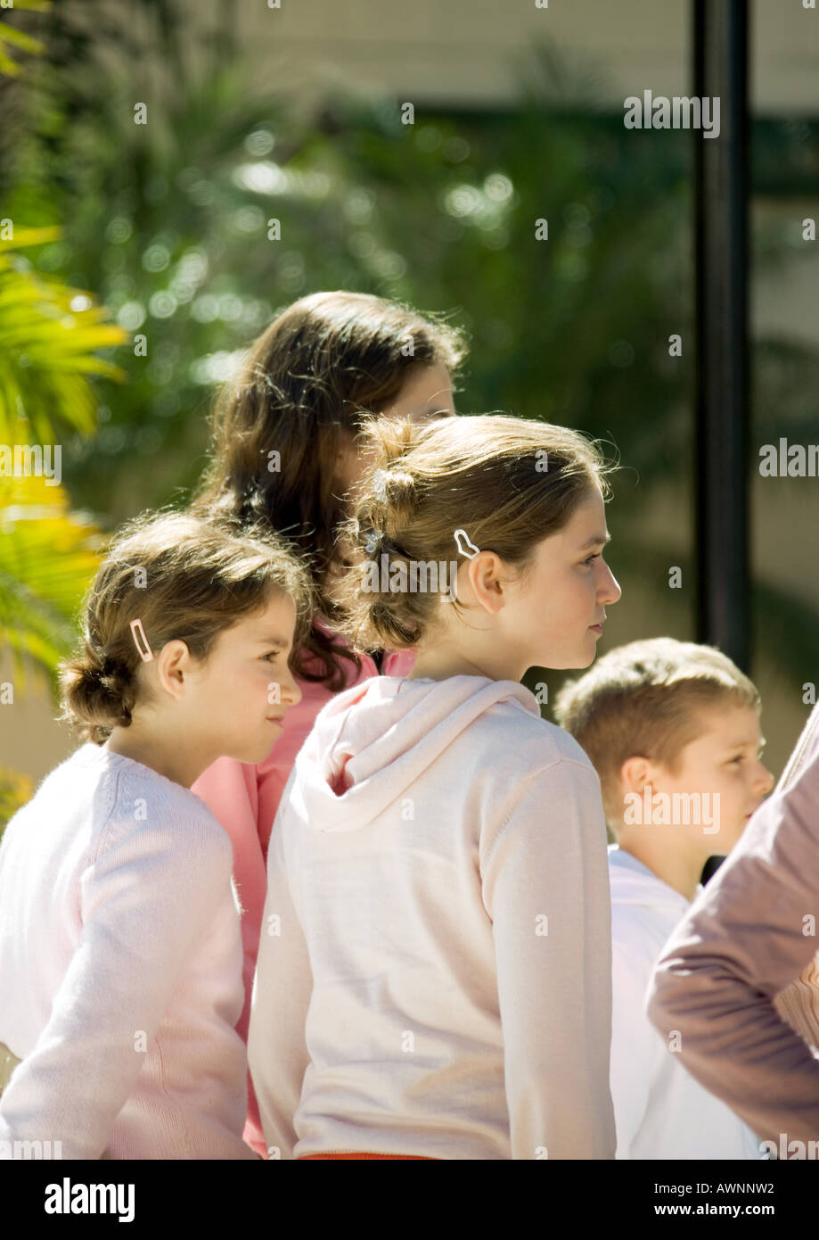 Group of children, looking in same direction - Stock Image